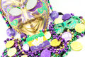 Mardi gras mask with beads and doubloons at an angle Royalty Free Stock Images