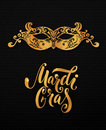 Mardi gras mask illustration. Vector golden type at black paper background. Masquerade invitation design. Royalty Free Stock Photo