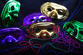Mardi Gras Masks and Beads on Black Royalty Free Stock Photo