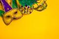 Mardi Gras Masks On Yellow Bac...