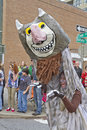 Mardi gras wild thing asheville north carolina usa march a yound woman in a parade hams it up in a children s book monster costume Stock Images