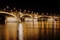 Margaret bridge budapest over danube river by night hungary Royalty Free Stock Image