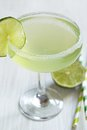 Margarita cocktail with lime on white table Stock Photos