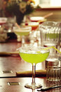 Margarita lime green glass of on a restaurant table Stock Photography