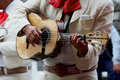 Mariachi playing guitar Royalty Free Stock Photo