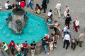 Marienplatz munich tourists relaxing on a fountain with sculptures on the Stock Images