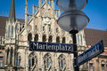 Marienplatz street sign over Munich town hall Royalty Free Stock Photography