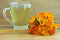 Marigold tea teacup with against wooden background Stock Photography