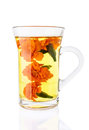Marigold tea in the transparent glass cup isolated on white Royalty Free Stock Photos