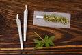 Marijuana background cannabis joint buds and hemp leaves on wooden table addictive drug or alternative medicine Stock Image