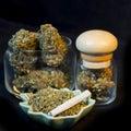 Marijuana bottles close up of bud and cigarette Stock Images
