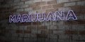 MARIJUANA - Glowing Neon Sign on stonework wall - 3D rendered royalty free stock illustration