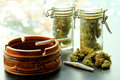 Marijuana Joints and Jars of Weed Royalty Free Stock Image