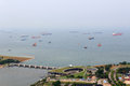 Marina Barrage dam and cargo ships lying in the roads off the coast of Singapore Royalty Free Stock Photo