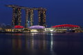 Marina bay sand in singapore flag colours at blue hour beautiful scene of the landscape mbs mbs is dress during national day on th Royalty Free Stock Image