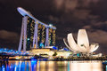 Marina bay sands the and artscience museum lit up at night along in singapore Stock Photo