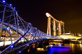 Marina bay sands with helix bridge in beautiful night time Royalty Free Stock Photo
