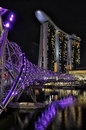 Marina bay sands singapore night view of the hotel and the double helix bridge Stock Photography