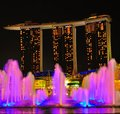 Marina bay sands a view of with sky park towers by night at the background in the foreground are the lighted water fountain Stock Photography