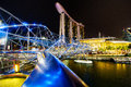 Marina bay singapore helix bridge and marina bay sand hotel at night a popular destination for cityscape singapore Stock Image