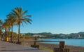 Marina & bay in St Antoni de Portmany,  Ibiza,  Balearic Islands, Spain.  Calm water along boardwalk & beach in warm, late day sun Royalty Free Stock Photo