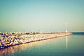 Marina with the lighthouse and the sea. vintage filtered image Royalty Free Stock Photo