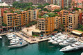 Marina and modern buildings in monte carlo monaco with yachts boats between view from above Royalty Free Stock Photography