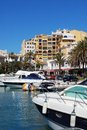 Marina puerto banus andalusia spain boats in the showing bars and restaurants to the rear cabopino marbella costa del sol malaga Stock Photo