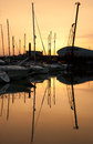 Marina yachts view of boats silhouette reflection at sunset Stock Photo