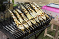 Marinate catfish on the grill Royalty Free Stock Photo