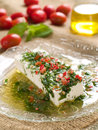 Marinated cheese goat with olive oil and parsley selective focus Royalty Free Stock Images