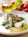 Marinated cheese goat with olive oil and parsley selective focus Royalty Free Stock Photo