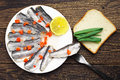 Marinated fish in a plate on vintage wooden table top view Royalty Free Stock Image