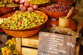 Marinated garlic and olives on provencal street market in Proven Royalty Free Stock Photo