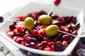 Marinated green olives with beans on plate Stock Images