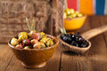 Marinated Olives in bowls with moroccan ornament on wood Royalty Free Stock Photo