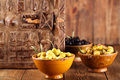 Marinated olives in bowls with moroccan ornament on wood shallow dof Royalty Free Stock Photos