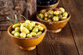 Marinated olives in bowls with moroccan ornament on wood shallow dof Royalty Free Stock Image