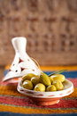 Marinated Olives in tajine bowls with moroccan  ornament on wood Royalty Free Stock Photo