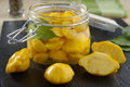 Marinated pattypans pattypan squash in a jar Stock Photos