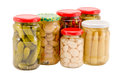 Marinated preserve ecologic organic food glass pot preserved vegetables mushrooms peppers cucumbers corns garlics in pots isolated Royalty Free Stock Photo