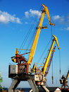 Marine cranes in cargo port closeup Stock Images