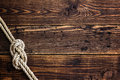 Marine knot on wooden deck Royalty Free Stock Photo