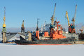 Marine rescue tug `Zeya` on the Kanonersky Ship Repair Plant on a sunny February day. Saint-Petersburg