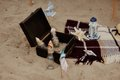 Marine still life on the sand box with bottles shells and starfish Royalty Free Stock Images