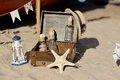 Marine still life on the sand box with bottles shells and starfish Royalty Free Stock Image