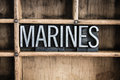 Marines concept metal letterpress word in drawer the written vintage type a wooden with dividers Stock Photos