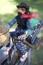 Marionette old and wicker basket on a miniature bike Royalty Free Stock Images