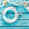 Maritime decoration with a life ring and fishnet Royalty Free Stock Photo