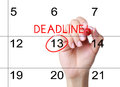 Mark the deadline on the calendar with red marker Stock Image